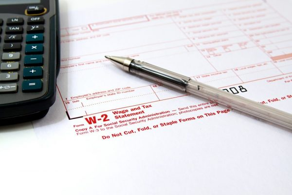 W-2 form, calculator and pen