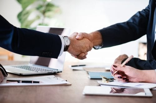 financial auditor in chicago - factors to consider when buying a business - shaking hands