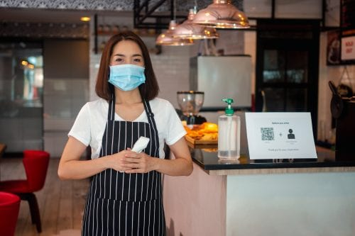 Restaurant owner with mask on